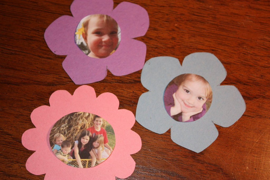 Photos of children make the center of the flowers for the DIY Mother's Day craft.